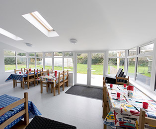Solid Tiled Roof Conservatory Interior with Skylight Windows