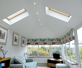 Solid Tiled Conservatory Roof Interior with Downlights and Roof Windows